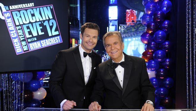 "Ryan Seacrest and Dick Clark ring in 2012 in New York's Times Square. This year, Seacrest says, ""I don't know what to expect in that first second when I sign on"" without his co-host."
