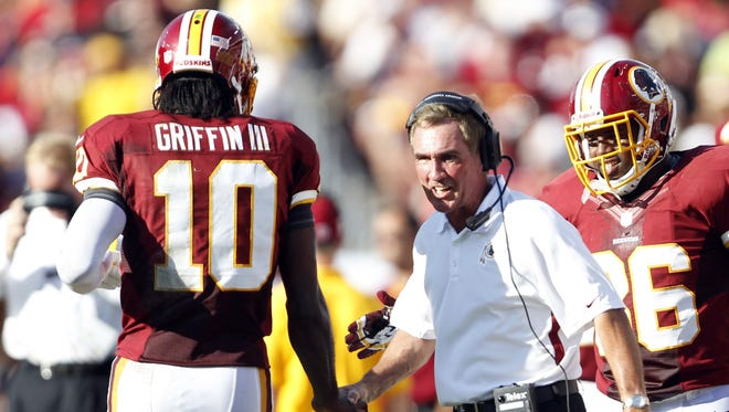 Rookie quarterback Robert Griffin III (10) and coach Mike Shanahan have sparked the Washington Redskins to the brink of the NFL playoffs.