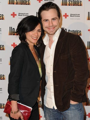 Rider  Strong and his fiancé Alexandra Barreto are seen here in 2010.