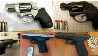 Some of the guns confiscated from passengers' carry-on bags in December.
