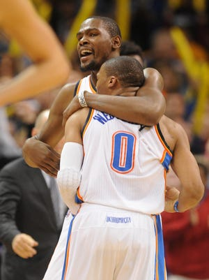 Thunder forward Kevin Durant, facing the camera, hugs guard Russell Westbrook during overtime of Thursday's 111-105 win.