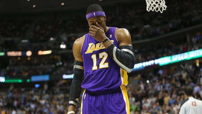 Lakers center Dwight Howard walks off the court after his ejection Wednesday for a flagrant 2 foul against the Nuggets' Kenneth Faried.