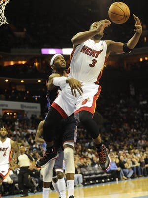 Heat guard Dwyane Wade is fouled by Bobcats center Brendan Haywood during Wednesday's Heat win.