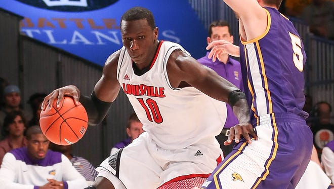 Louisville center Gorgui Dieng (10) drives past Northern Iowa guard Matt Bohannon (5) in the first half during the 2012 Battle 4 Atlantis in the Imperial Arena at the Atlantis Resort. Dieng is returning to action for the first time since Nov. 23 on Saturday, just in time for his Senegalese parents to watch him in person.