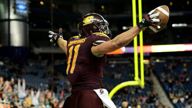 Central Michigan wide receiver Cody Wilson celebrates after catching a touchdown pass in the fourth quarter of the 2012 Little Caesars Bowl against Western Kentucky at Ford Field.