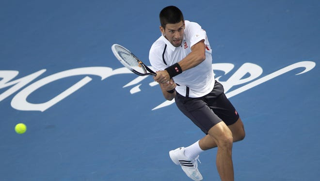 Novak Djokovic of Serbia routs David Ferrer of Spain to reach the final in Abu Dhabi.