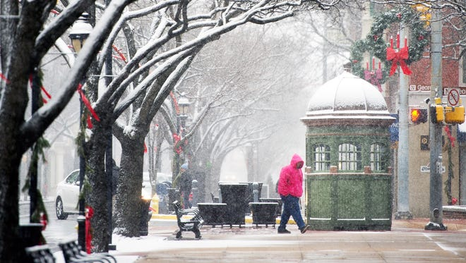 Snow falls on Continental Square in York, Pa., on Wednesday.