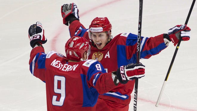 Russia's Albert Yarullin, right, celebrates his first-period goal with teammate Nikita Nedsterov.