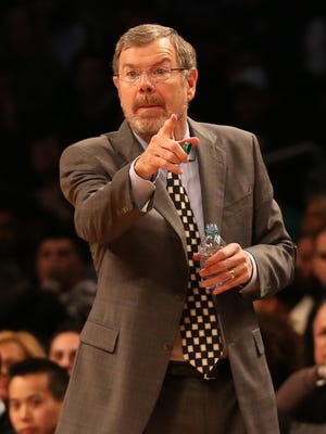 P.J. Carlesimo, making his Nets interim-coaching debut, directs his team against the Bobcats during Friday's 97-81 win.