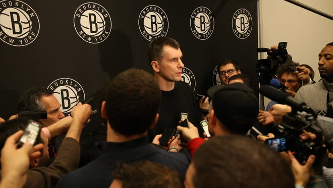 Nets owner Mikhail Prokhorov addresses news media during halftime of Friday's game.
