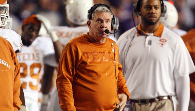 Texas coach Mack Brown on Friday announced two suspensions hours after two Longhorns players were linked to an alleged sexual assault.