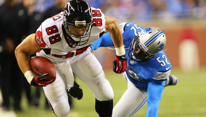 Atlanta Falcons tight end Tony Gonzalez is pushed out of bounds by Detroit Lions outside linebacker Justin Durant.