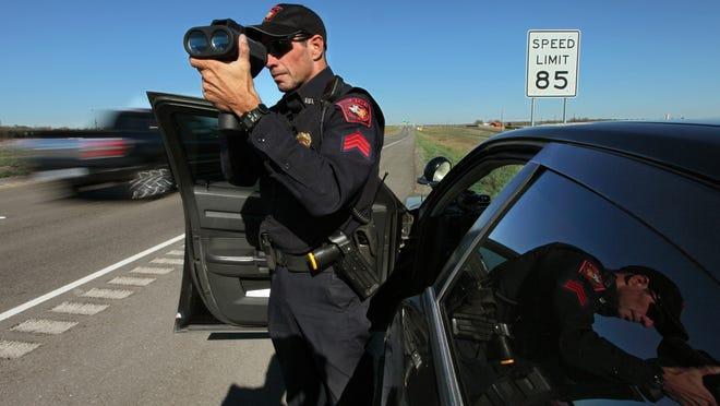 Mustang Ridge Police Sgt. John Bennett checks speeds on Highway 130 south of Austin, Texas.