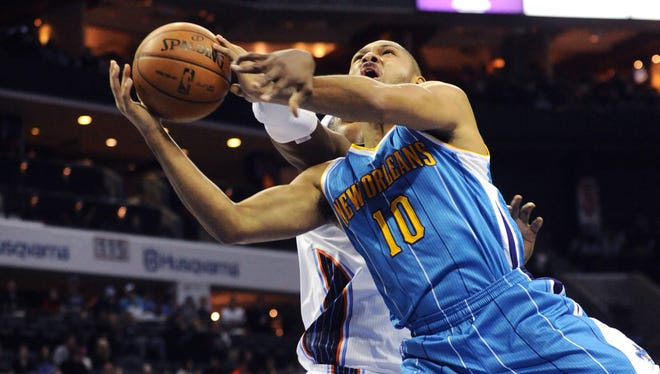 New Orleans Hornets guard Eric Gordon (10) gets fouled by Charlotte Bobcats center Brendan Haywood (33) as he drives to the basket during the game at Time Warner Cable Arena.