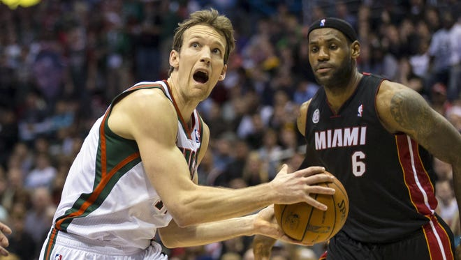 Milwaukee Bucks forward Mike Dunleavy (17) drives for the basket in front of Miami Heat forward LeBron James (6) during the fourth quarter at the BMO Harris Bradley Center.