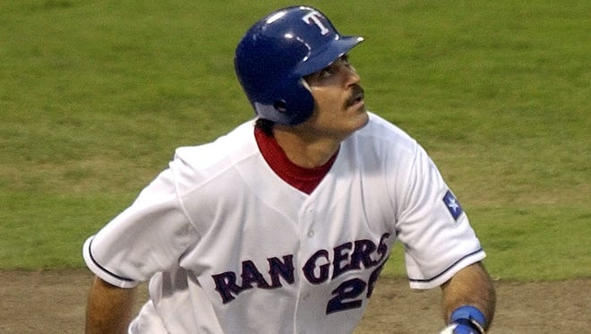 Rafael Palmeiro  looks skyward after hitting his 510th home run against Seattle Mariners pitcher Gil Meche on July 6, 2003. He finished his career with 569 homers.