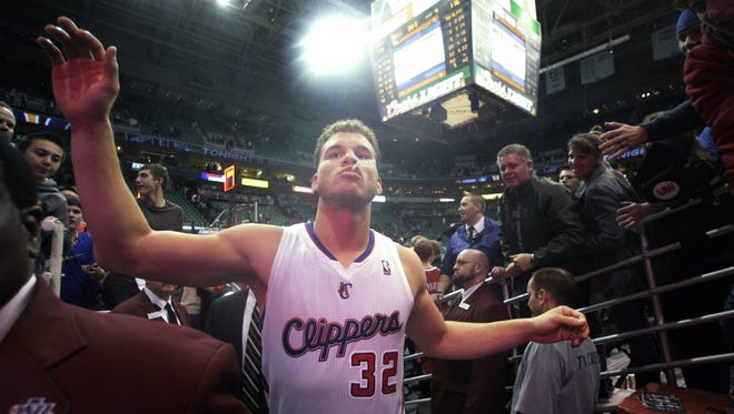 Clippers power forward Blake Griffin greets fans after Friday's 116-114 win vs. the Jazz.
