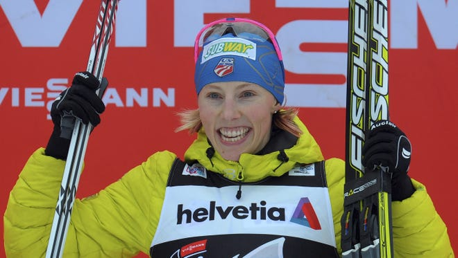Kikkan Randall of the United States celebrates on the podium after the women's freestyle 3.1 kilometer prologue at the cross country Tour de Ski competition in Oberhof, central Germany, Saturday.