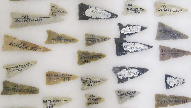 Dozens of arrowheads were among the more than 600 items recovered by archaeologists from an ancient Sinagua grave near Flagstaff, Ariz.; those sacred items and remains of a man nicknamed ?the Magician? reportedly were repatriated to the Hopi Tribe in secret proceedings.