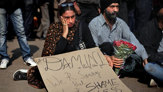 Indians attend a gathering in New Delhi on Saturday to mourn the death of a rape victim.