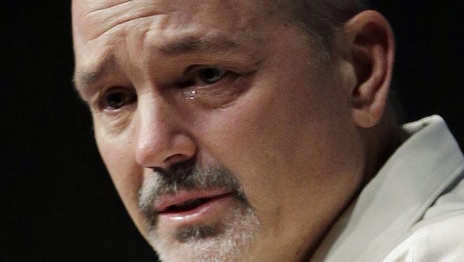 Chuck Pagano speaks during a news conference