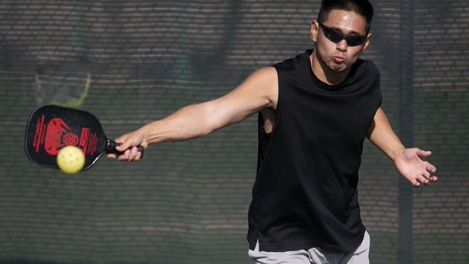 Steve Wong of Surprise, Ariz., plays pickleball at the pickleball courts in Surprise on Tuesday,  December 4, 2012.