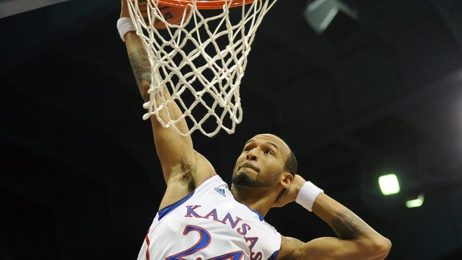 Kansas Jayhawks guard Travis Releford dunks against the American Eagles in the first half at Allen Fieldhouse.