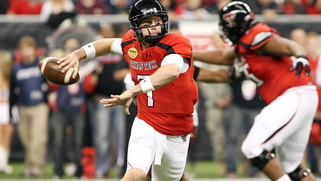 Texas Tech Red Raiders quarterback Seth Doege looks for an open receiver against the Minnesota Golden Gophers during the second quarter