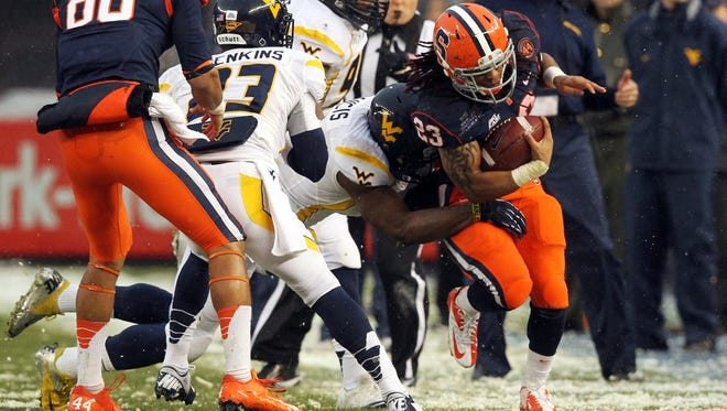 Syracuse Orange running back Prince-Tyson Gulley runs the ball against the West Virginia Mountaineers during the first quarter of the New Era Pinstripe Bowl at Yankee Stadium.