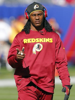Redskins safety DeJon Gomes delivered the hit that injured Adrian Peterson in 2011.