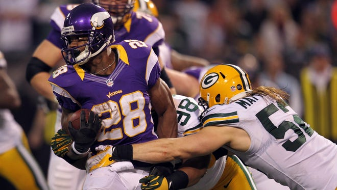 Vikings running back Adrian Peterson carries the ball against the Packers, gaining 199 yards in a victory.
