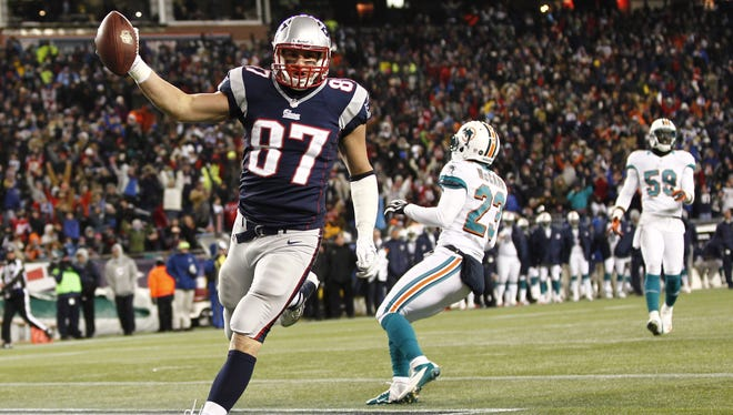 New England Patriots tight end Rob Gronkowski (87) scores a touchdown against the Miami Dolphins during the second half at Gillette Stadium.