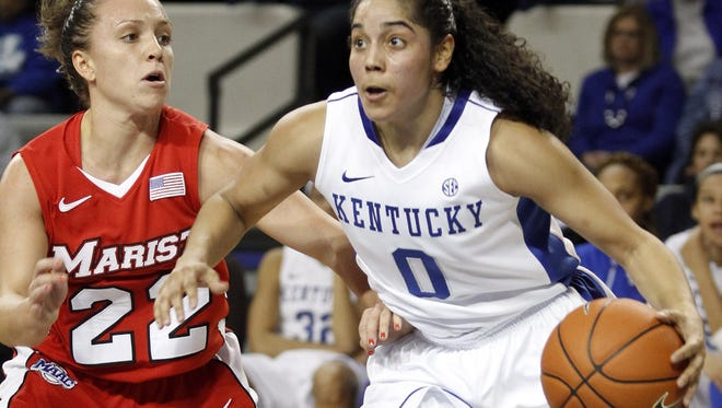 Kentucky's Jennifer O'Neill is pressured by Marist's Kristine Best during the second half at Memorial Coliseum in Lexington, Ky. Kentucky defeated Marist 78-56.