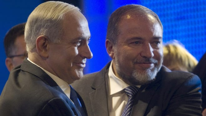 Israeli Prime Minister Benjamin Netanyahu, left, and Israeli Foreign Minister Avigdor Lieberman, are seen during the inauguration of their election campaign in Jerusalem, on Dec. 25.