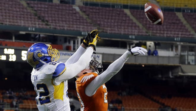 Bowling Green defensive back Aaron Foster (23) blocks a pass intended for San Jose State tight end Ryan Otten (82) during the second half of Military Bowl on Thursday at RFK Stadium. The game was the lowest-attended bowl game since USA TODAY Sports began tracking bowl attendance in 2004-05.