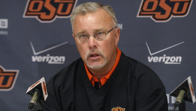 Oklahoma State women's basketball head coach Jim Littell answers a question during a news conference in Stillwater, Okla., on Oct. 22, 2012.
