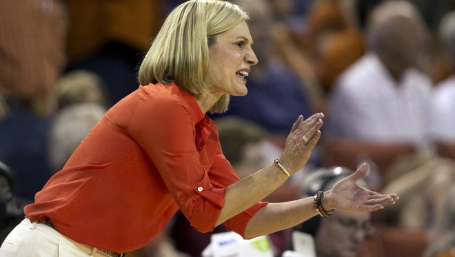 Texas head coach Karen Aston directs her team against Tennessee at the Frank Erwin Center in Austin, Texas, on Dec. 16