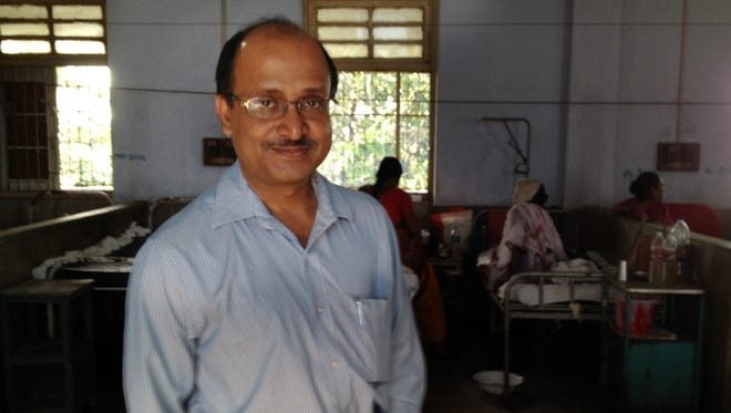 Dr. Partha Basu stands in the women's ward at Chittaranjan National Cancer Institute in Kolkata, India, on Friday, Oct. 19, 2012. He has been involved with doctors from Louisville, Ky., in a study of a new cervical cancer treatment. (Gannett, Laura Ungar/The (Louisville, Ky.) Courier-Journal)