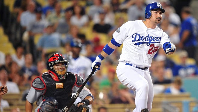 """Four-time All-Star Adrian Gonzalez, acquired from the Red Sox last season, says everybody has """"to be on the same page"""" if the Dodgers are to dethrone the Giants."""