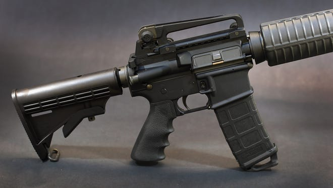 Photo illustration shows a Rock River Arms AR-15 rifle. The weapon is similar in style to the Bushmaster AR-15 rifle that was used during the massacre at Sandy Hook elementary school in Newtown, Conn.