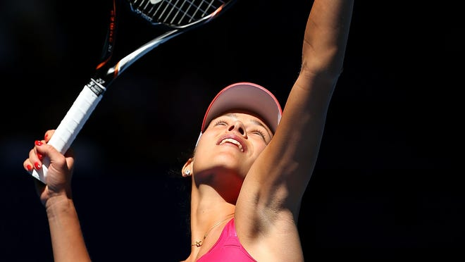 Ana Ivanovic of Serbia serves in her singles match against Francesca Schiavone of Italy during day three of the Hopman Cup at Perth Arena in Perth, Australia.