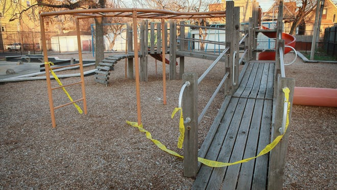 Crime scene tape hangs from the playground equipment where 16-year-old Jeffrey Stewart collapsed after being shot in Chicago.