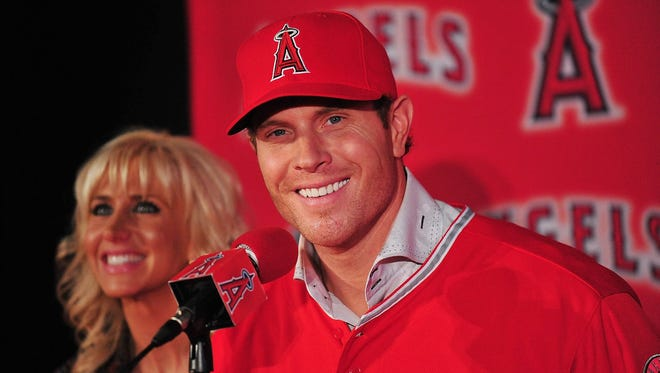 """Josh Hamilton was all smiles after signing a five-year, $125 million contract with the Angels. """"It's exciting to be here, to think about this lineup and what it's capable of,"""" he said."""