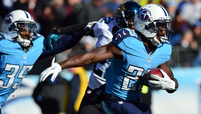 The Titans' Darius Reynaud (25) returns a punt for a touchdown against the Jaguars Sunday at LP Field.