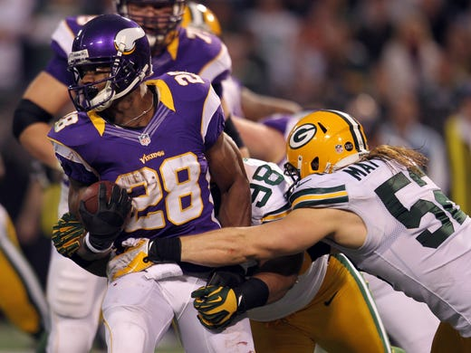 415aae5db9c Minnesota Vikings running back Adrian Peterson (28) carries the ball during  the first quarter