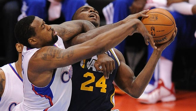 Los Angeles Clippers center DeAndre Jordan (6) fights to block a shot by Utah Jazz power forward Paul Millsap (24) during the first half at Staples Center.