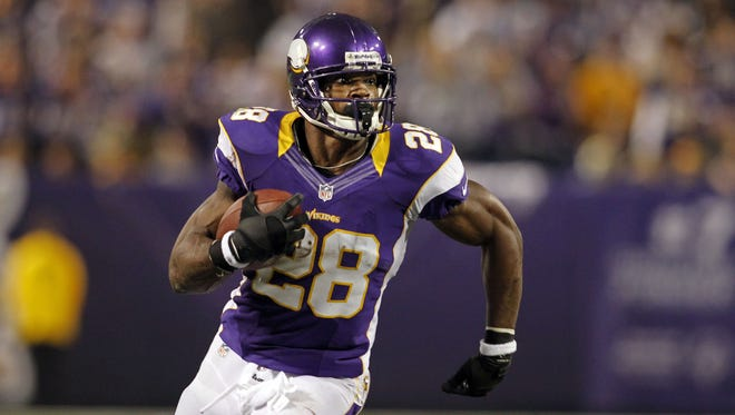 Minnesota Vikings running back Adrian Peterson (28) rushes against the Green Bay Packers in the second quarter at the Metrodome. The Vikings won 37-34.