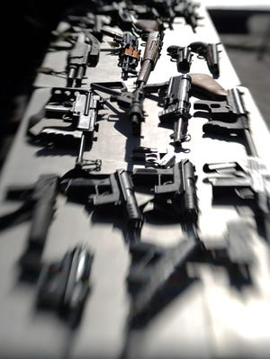 Collected assault weapons are displayed during the LAPD Gun Buyback Program event  December 26, 2012 in the Van Nuys area of north Los Angeles. Research on the public health impact of guns is limited by legislation backed by the National Rifle Association, some physicians and researchers say.
