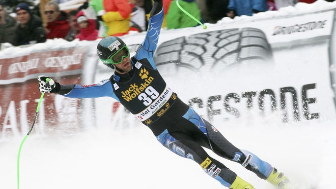 In this Dec. 15, 2012 file photo, Steven Nyman, of the United States,  celebrates after winning a men's World Cup downhill, in Val Gardena, Italy.