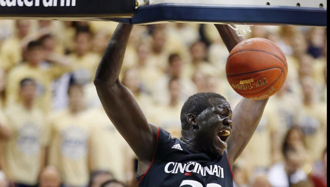 Cincinnati's David Nyarsuk (33) dunks in front of Pittsburgh's Talib Zanna (42) in the second half of their Big East opener Monday. The Bearcats won 70-61.